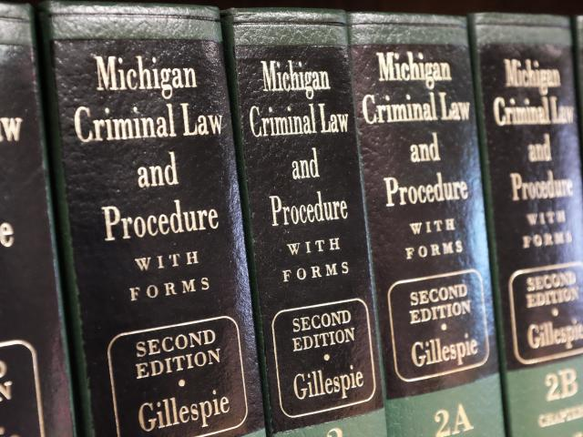 Michigan Law books on shelf.